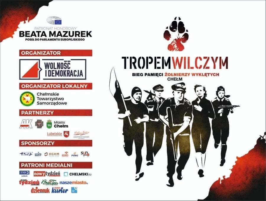 plakat biegu naktórymznajduje się grupa ludzi orazloga sponsorów wydarzenia